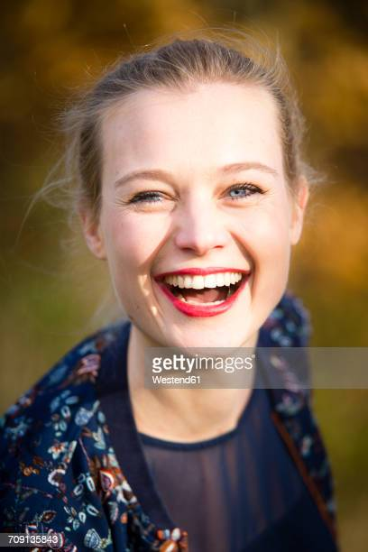 Portrait of laughing young woman in autumn