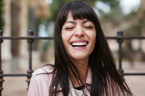 Portrait of laughing young woman outdoors - gettyimageskorea