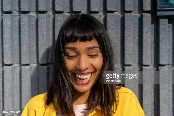 portrait of laughing young woman - nose piercing stock pictures, royalty-free photos & images