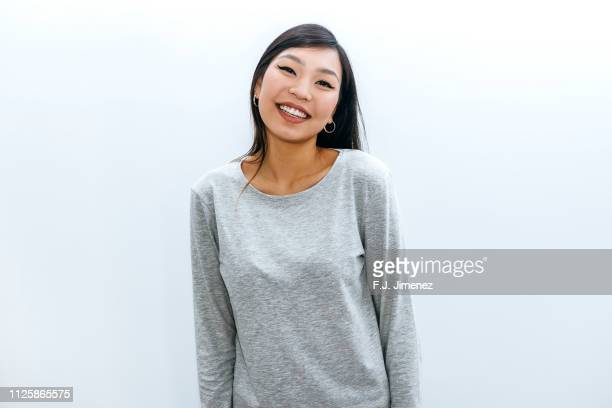 portrait of laughing young woman - asian model stock photos and pictures