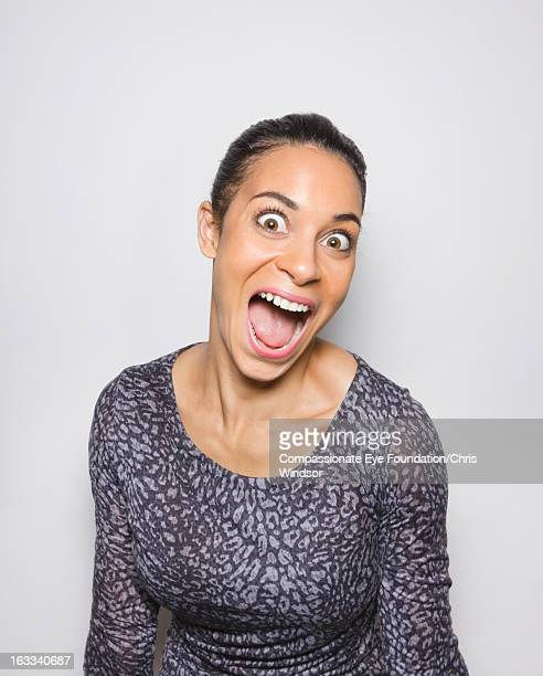 portrait of laughing young woman - one mid adult woman only stock pictures, royalty-free photos & images