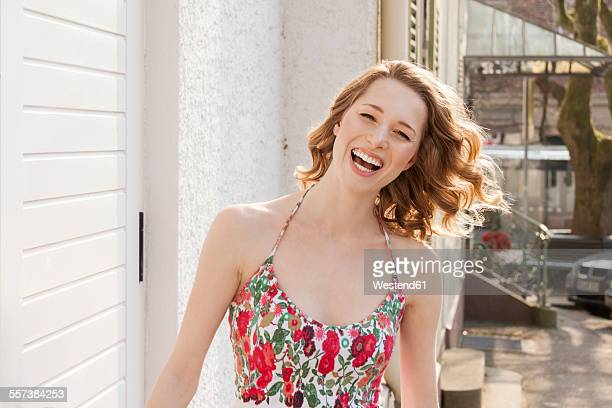 portrait of laughing young woman with curly hair - スパゲティタンクトップ ストックフォトと画像