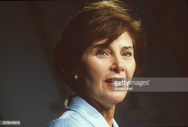 Portrait of Laura Bush as she speaks at a lunch in her honor.