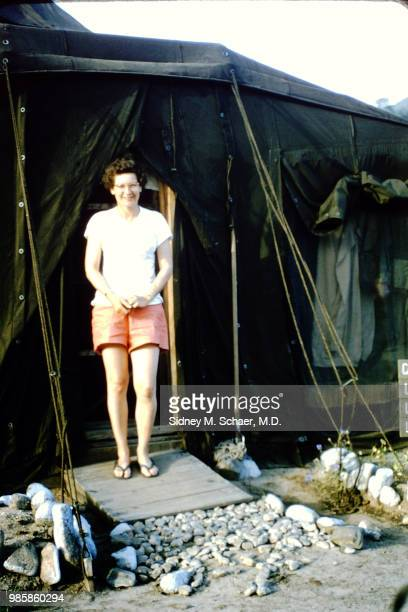Portrait of Laura Wilson of the neurosurgical team at the 8063rd MASH as she stands in the doorway of a tent South Korea January 1952