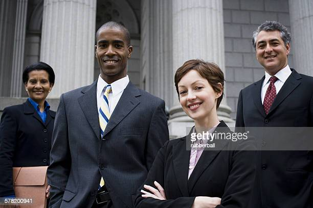 Portrait of lawyers in front of a courthouse