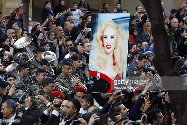 Portrait of Lebanese singer Sabah, whose real name was Jeanette Gergis Al-Feghali, is carried by people during the funeral ceremony held at Saint...