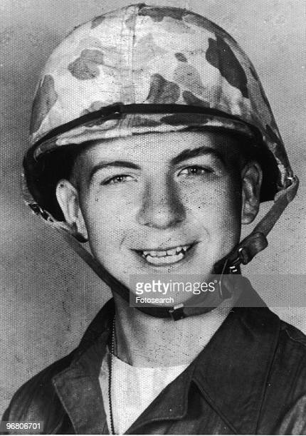 Portrait of Lee Harvey Oswald wearing an army helmet circa 1960s