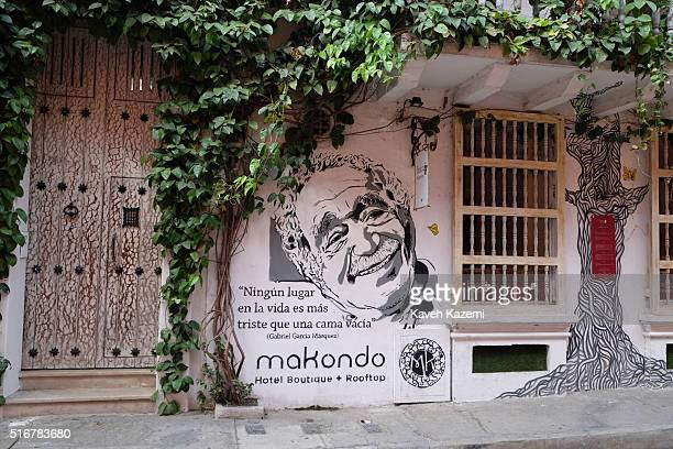 CARTAGENA of INDIAS COLOMBIA JANUARY 29 2016 A portrait of legendary Colombian novelist Gabriel Garcia Marquez appears on a mural outside a boutique...