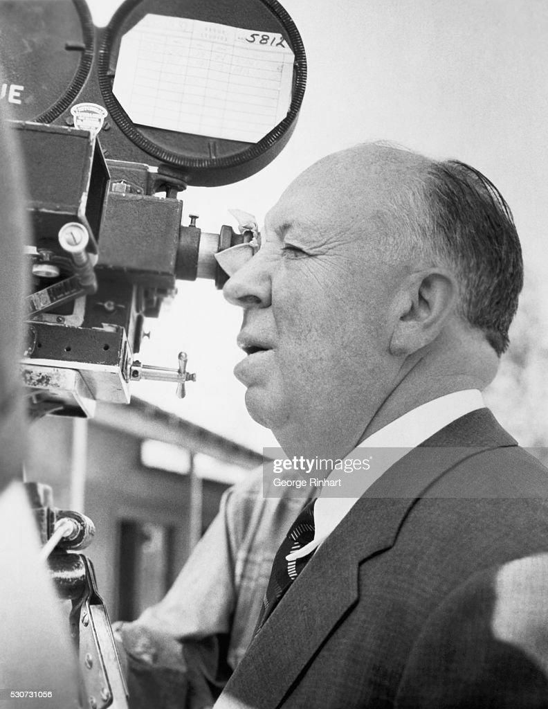 1963- Portrait of Legendary English director, Alfred Hitchcock, looking throough the camera.