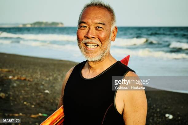 portrait of legendary surfer - japanese old man stock pictures, royalty-free photos & images