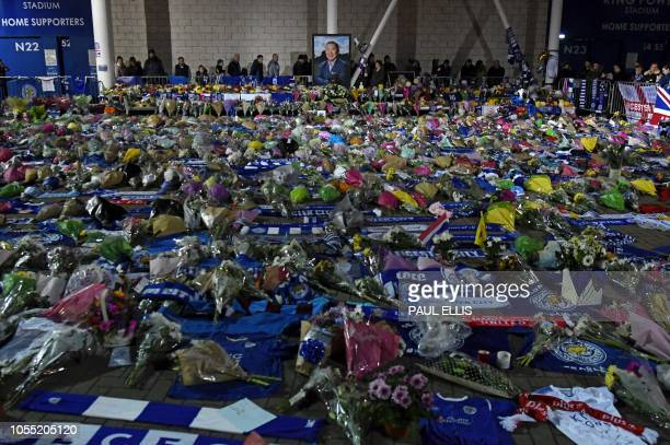 TOPSHOT A portrait of Leicester City Football Club's Thai chairman Vichai Srivaddhanaprabha who died in a helicopter crash at the club's stadium is...