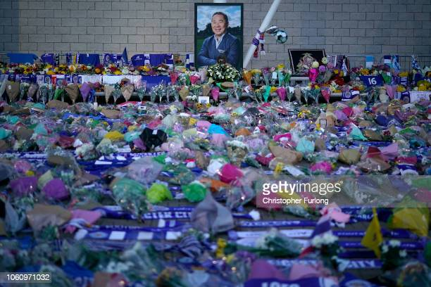 Portrait of Leicester City Football Club's Thai chairman Vichai Srivaddhanaprabha who died in a helicopter crash, looks out over a sea of tributes at...
