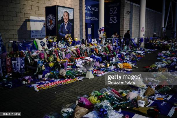 A portrait of Leicester City Football Club's Thai chairman Vichai Srivaddhanaprabha who died in a helicopter crash looks out over a sea of tributes...