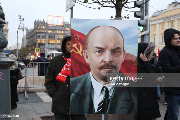 A portrait of Lenin seen at the march Thousands marched to Revolution Square in central Moscow to commemorate the 100th anniversary of the Russian...