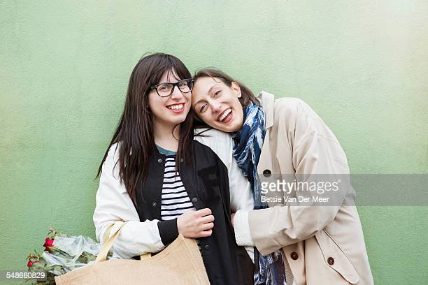 Portrait of lesbian couple with shopping bag.