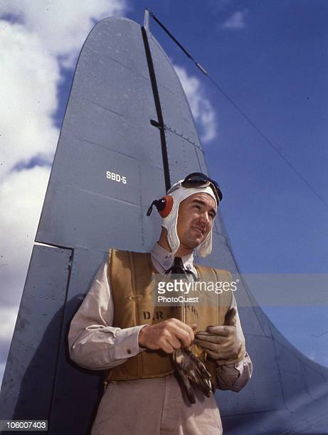 Portrait of Lieutenant David Beery USNR posing by the tail of a Douglas SBD5 aircraft at the Air Operational Traininig Command Jacksonville FL where...