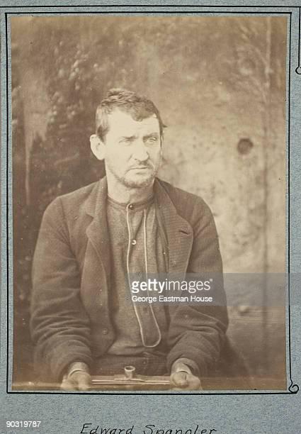 Portrait of Lincoln conspirator Edmund Spangler in handcuffs after his arrest Washington DC 1865