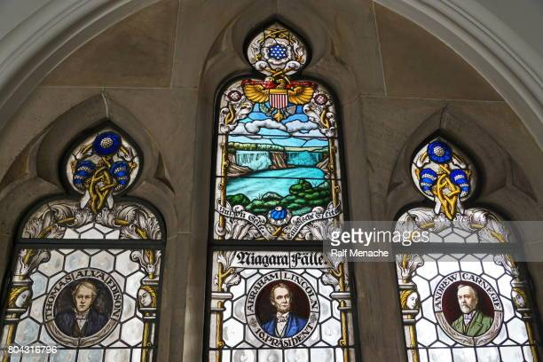 portrait of lincoln, edison, carnegie and the niagara falls as stained-glass windows. bavaria, munich new town hall. - andrew carnegie stock pictures, royalty-free photos & images