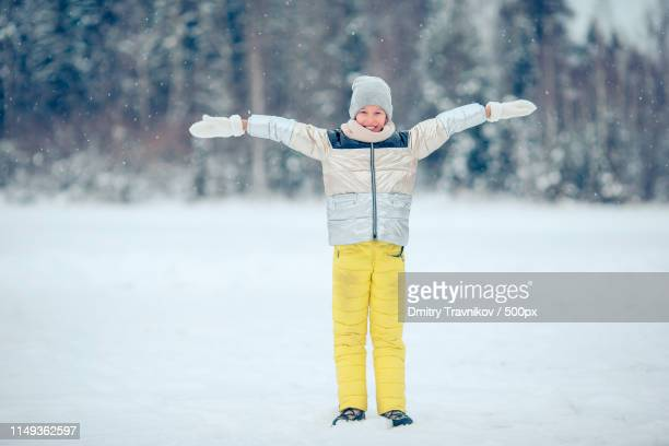 portrait of little adorable girl in snow sunny winter day - ski wear stock pictures, royalty-free photos & images