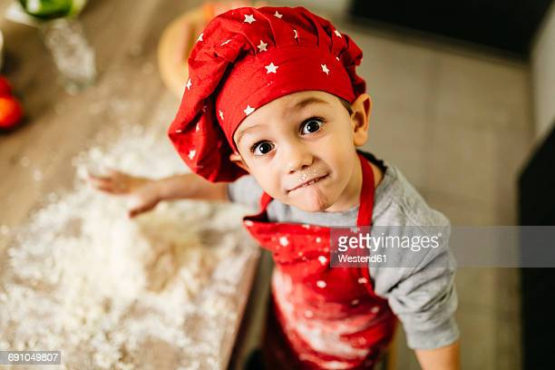 Portrait of little boy in kitchen