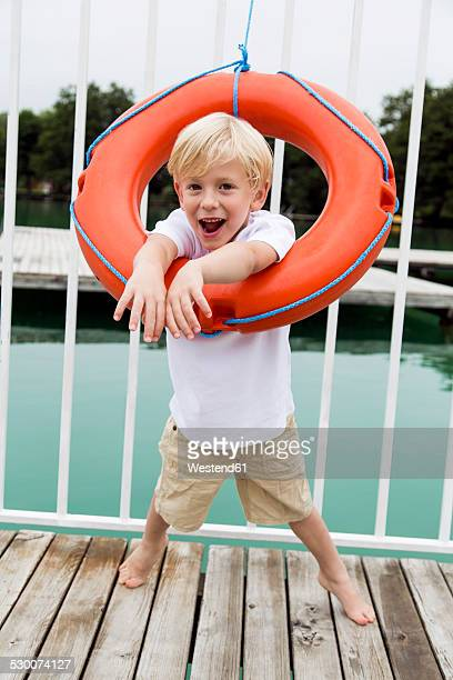 Portrait of little boy looking through a lifesaver