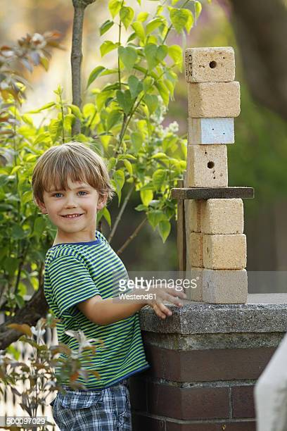 Portrait of little boy playing with wooden cubes