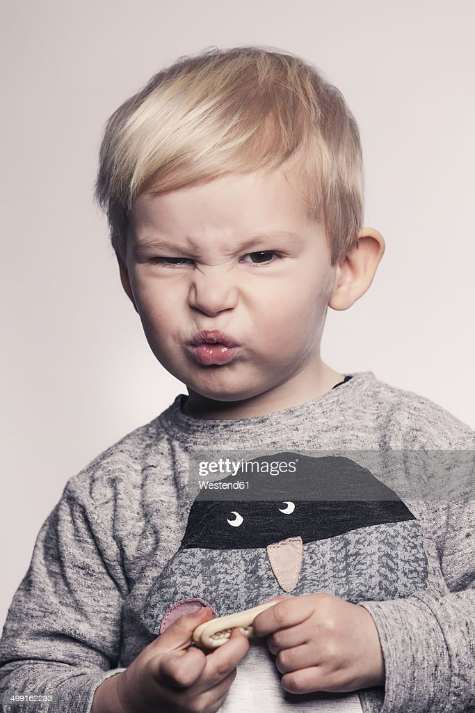 4 Year Boy Bedroom Decorating Ideas: Portrait Of Little Boy Pouting A Mouth Stock-Foto