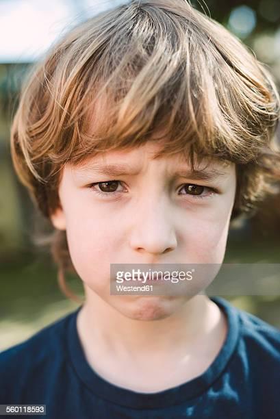 Portrait of little boy pouting mouth