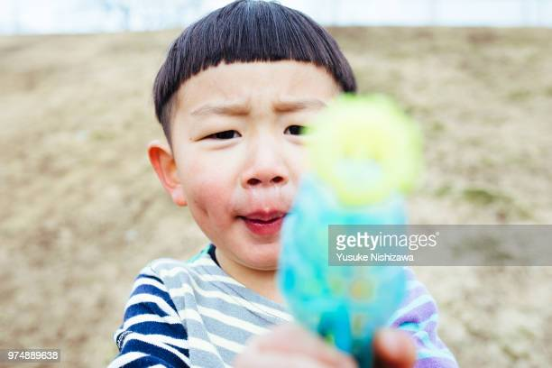 portrait of little boy pulling funny faces - yusuke nishizawa stock pictures, royalty-free photos & images