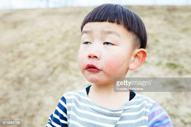portrait of little boy pulling funny faces - 変な顔 ストックフォトと画像