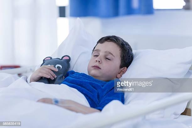 Portrait of little boy sleeping in a hospital bed