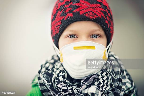Portrait of little boy wearing pollution mask