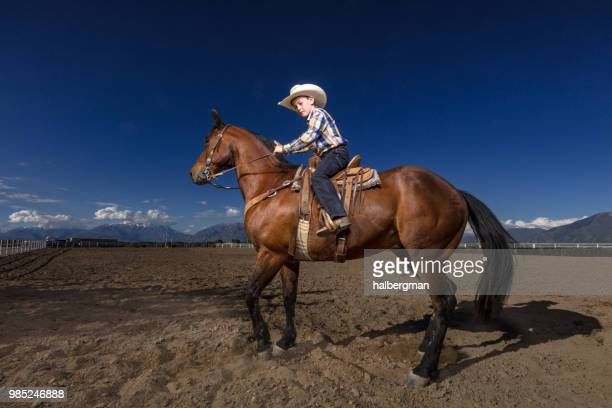 Portrait of Little Cowboy on Horseback