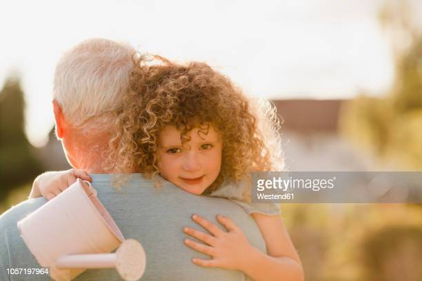 Portrait of little girl cuddling her uncle