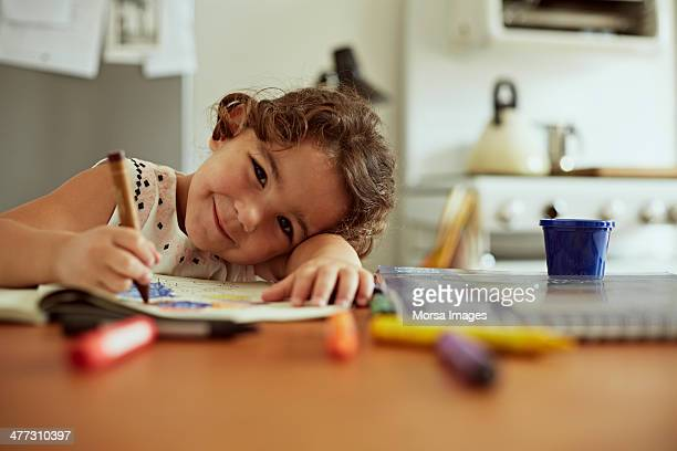 portrait of little girl drawing - colouring book stock photos and pictures