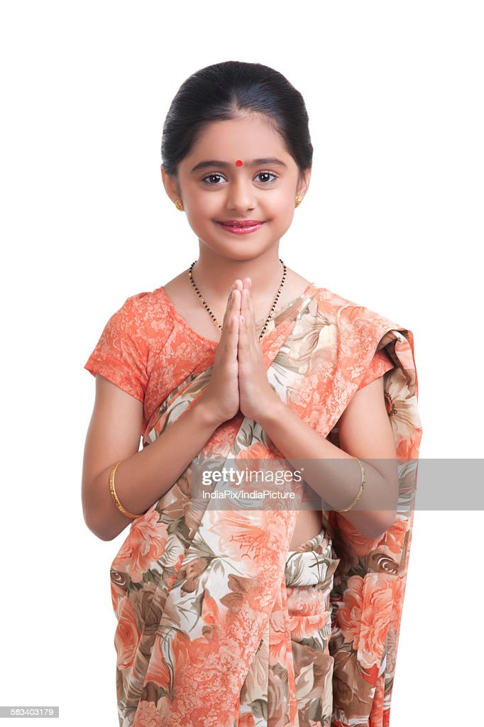 Portrait of little girl dressed as housewife greeting : Stock Photo