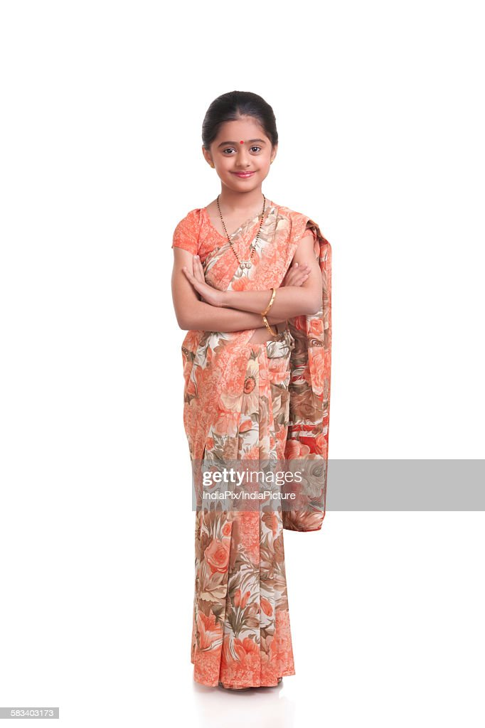 Portrait of little girl dressed as housewife : Stock Photo