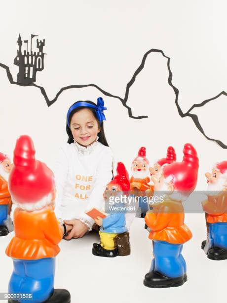 portrait of little girl dressed up as snow white with the seven dwarfs - snow white foto e immagini stock