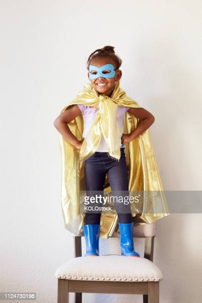 portrait of little girl dressing up as a superhero - superhero stock pictures, royalty-free photos & images