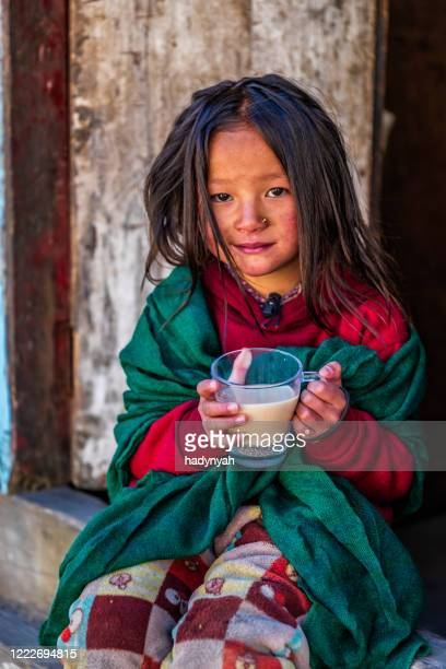 portrait of little girl drinking milk tea, mount everest national park, nepal - unesco world heritage site stock pictures, royalty-free photos & images