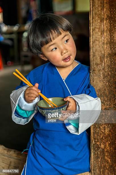Portrait of little girl eating dinner