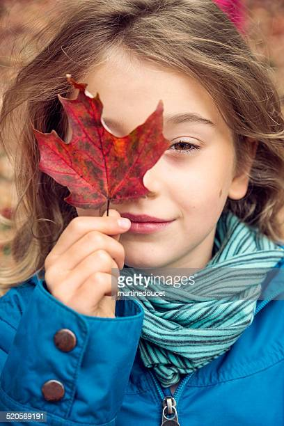 "portrait of little girl holding an autumn maple leave. - ""martine doucet"" or martinedoucet stock pictures, royalty-free photos & images"