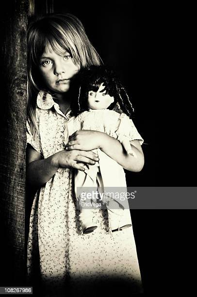 Portrait of Little Girl Holding Doll, Black and White