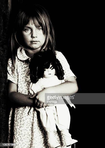 portrait of little girl holding doll, black and white - dirty little girls photos stock pictures, royalty-free photos & images