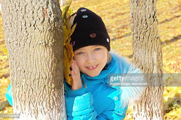 Portrait of little girl in autumnal park