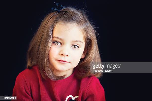 portrait of little girl in red - rebecca nelson stock pictures, royalty-free photos & images