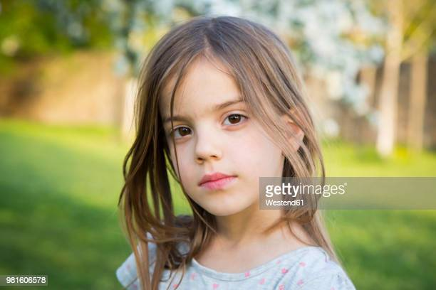 portrait of little girl in the garden - bambine femmine foto e immagini stock