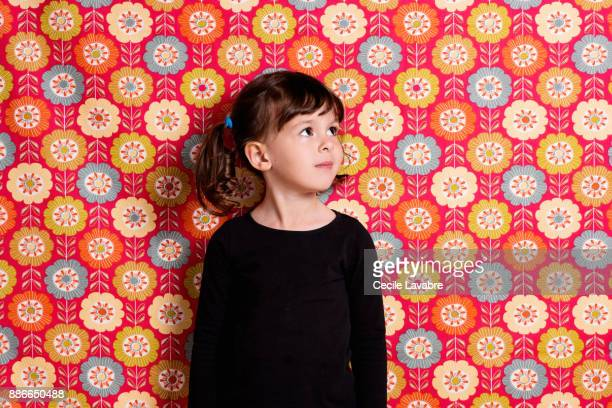 Portrait of little girl looking up