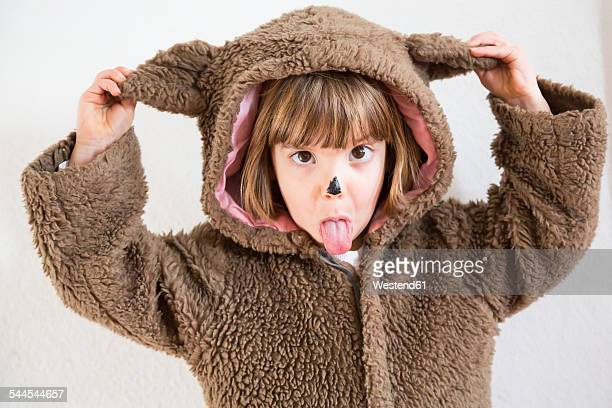 portrait of little girl masquerade as a bear making a face - bear suit stock pictures, royalty-free photos & images