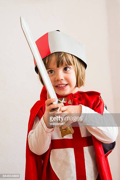 Portrait of little girl masquerade as a knight